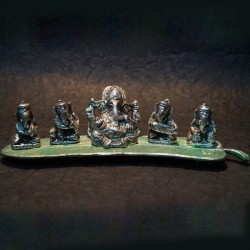 Lord Ganesha sitting on a banana leaf with musicians aluminium idol