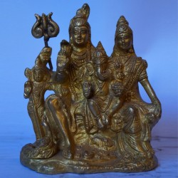 Blessing Lord Shiva with his family brass idol