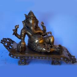 Relaxing Ganesha antique brass statue