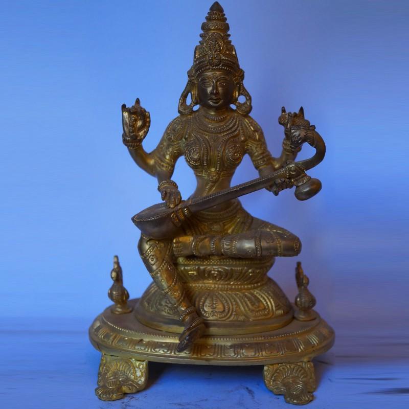 Saraswati holding veena brass statue