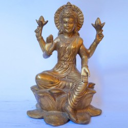 Shining brass Lakshmi devi sitting on Lotus flower