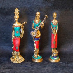 Traditional brass tribal woman figurines with coral dress on top