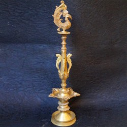 Traditional brass deepa stand with peacock on top