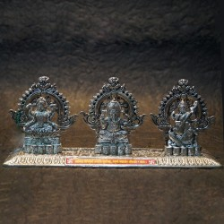 Lord Ganesha with Lakshmi Saraswathi sitting on peeta