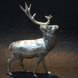 Two horns deer made of aluminium idol
