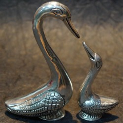 Aluminium duck with its duckling idols