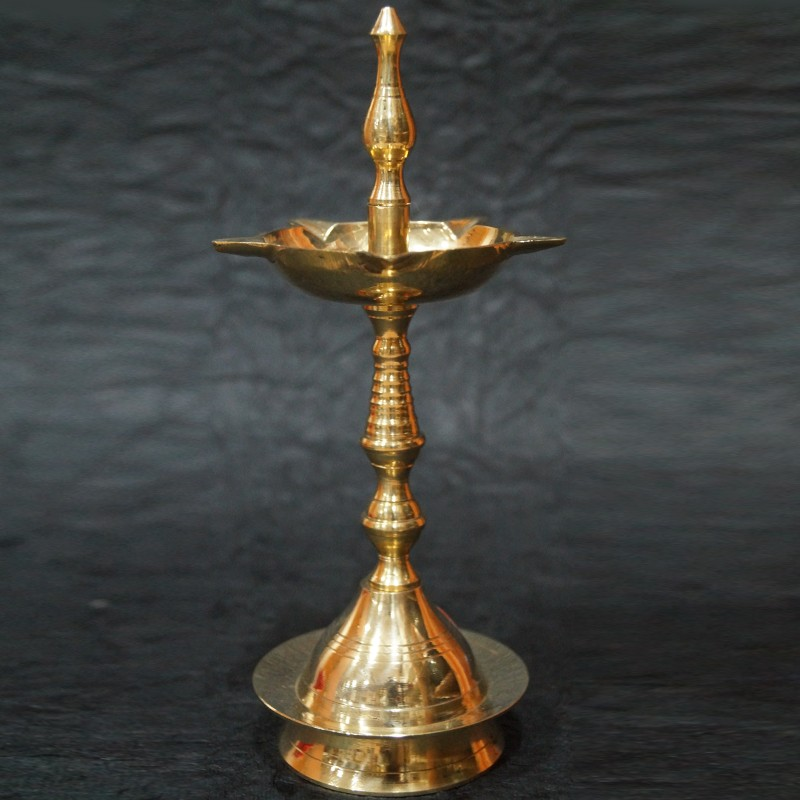 Brass diyas (lamps) for puja on festival decoration online