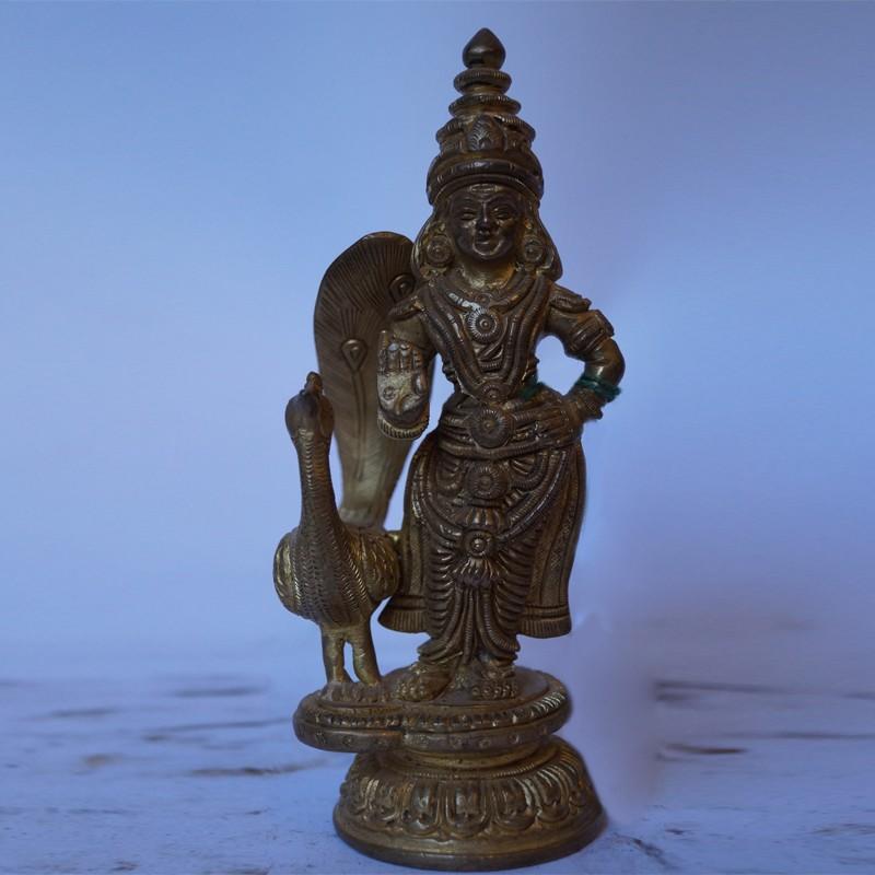 Lord Subramanya with peacock brass idol