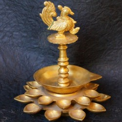 Traditional brass deepas with peacock on top